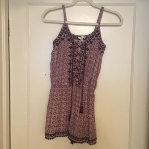 Maroon, black, and white patterned romper